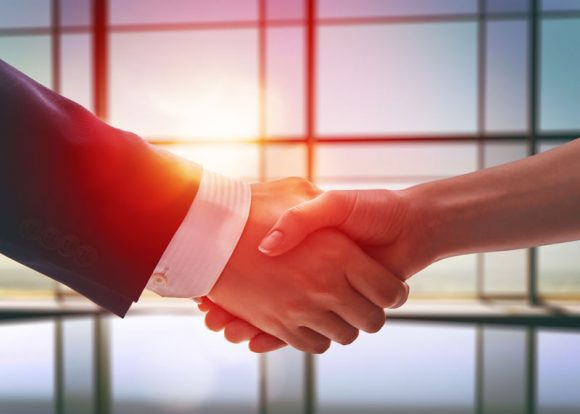 IFF Invest_Business People Shaking Hands Image