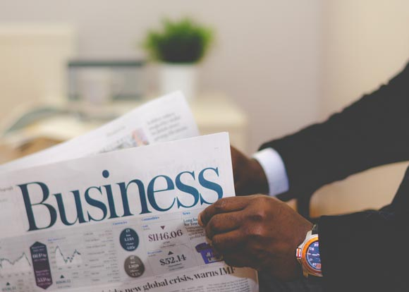 IFF Services_Businessman Reading Newspaper Image